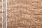 Lace ribbon on burlap cloth — Foto de Stock
