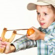 Kid holding slingshot in hands — Stock Photo #65323255