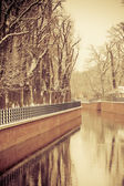 Park with river and embankment covered with snow — Stock Photo