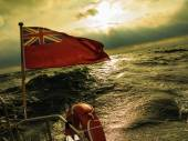 British flag flown from yacht — Stock Photo