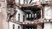 Building demolition by machinery — Stock Photo