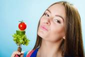 Girl holding fork with vegetables — Stock Photo