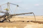 Excavator in coal mine — Stock Photo