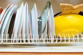 Drainer with clean dishes — Stock Photo