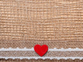 Red heart on  cloth — Stock Photo