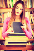 Student in college library — Stock Photo