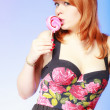 Girl holding pink lollipop — Stock Photo #66166401