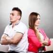 Young couple after quarrel sitting on sofa back to back — Stock Photo #66236281