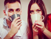 young funny couple drinking tea or coffee — Photo