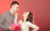 Man surprising cheerful woman — Stock Photo