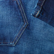 Closeup detail of blue denim pocket — Stock Photo #66912759