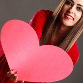 Girl holding red heart — Stock Photo