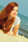 Beautiful redhaired girl lying — Stockfoto