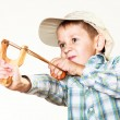 Kid holding slingshot in hands — Stock Photo #67193453
