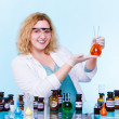 Chemist with chemical glassware test flask — Stock Photo #67276911