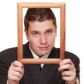 Man framing his face with frame — Stock Photo