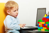 Boy using laptop  at home — Stock Photo