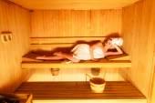 Woman lying  in wooden sauna — 图库照片