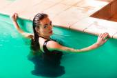 Woman posing in water. — Stock Photo