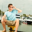 Man sitting on pier — Stock Photo #67929375