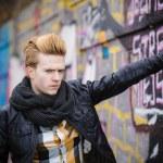 Man posing against graffiti wall — Stock Photo #67929399