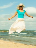 Girl in summer clothing jumping — Stock Photo