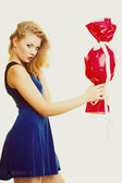 Girl holding red gift — Stock Photo