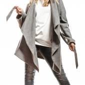 Woman in gray coat posing — Stock Photo