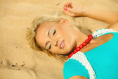 Blonde girl relaxing on beach — Stock Photo