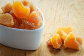 Closeup candied dried ginger in white bowl — Stock Photo
