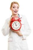 Doctor holding clock — Stock Photo