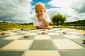 Boy  playing checkers — Stock Photo