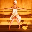 Woman sitting relaxed in sauna — Stock Photo #69661965