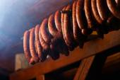Traditional food. Smoked sausuages in smokehouse. — Stock Photo