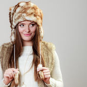 Woman in winter fur cap smiling — Stock Photo