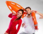 Lifeguards holding equipment — Stock Photo