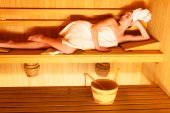 Woman lying  in wooden sauna — 图库照片