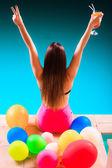 Blissful woman having fun at swimming pool — Stock Photo