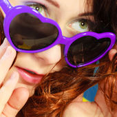 Girl in violet sunglasses portrait — Stock Photo