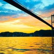 Sunset over suspension bridge in Bergen, Norway — Stock Photo #70447307