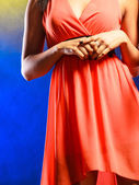 Woman part body in evening dress. — Stock Photo
