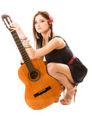 Girl holding acoustic guitar — Stock Photo