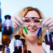Woman holding test flasks — Foto de Stock   #70854233