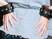Arrest and jail. Closeup handcuffs on female hands — Stock Photo