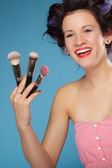 Woman  holding makeup brushes — Stock Photo