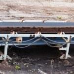 Opencast brown coal mine. Belt conveyor. — Stock Photo #71127755
