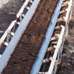 Opencast brown coal mine. Belt conveyor. — Stock Photo #71127757