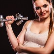 Athletic woman working with heavy dumbbells — Stock Photo #71459721