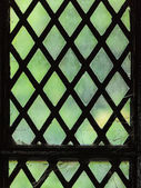 Green stained glass window with regular block pattern — Stock Photo