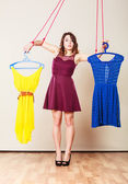 Addicted to shopping woman girl marionette with clothes — Stock Photo